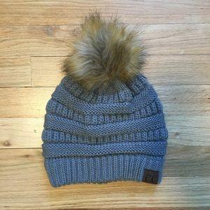 Gray CC beanie winter hat with pom pom.